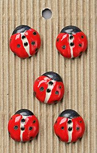 Incomparable Buttons!  They're handmade and SO cute!  Get 2 sets because button holes usually come in 6's!