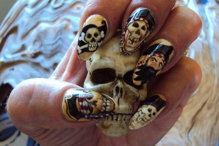 """chrissynailart: """"For National Pirates Day Sept 19th, 2014 The pirate Blackbeard is pictured on my ring finger. The words 'Dead Men Tell No Tales' is painted on a banner under my middle finger skull..."""