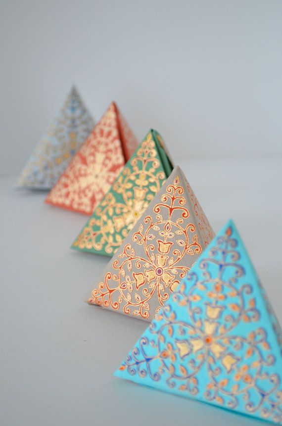 The Pyramid Box  This set of 5 small prism shaped boxes come in assorted colors with ornate gold floral designs. Boxes ship to you flat and are easy