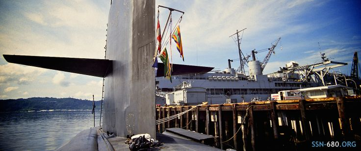 U.S.S. William H. Bates (SSN-680) displays her finery, tied up next the pier in Subic Bay, Olongapo, Phillipines - 1983 (photo by Brad Williamson)