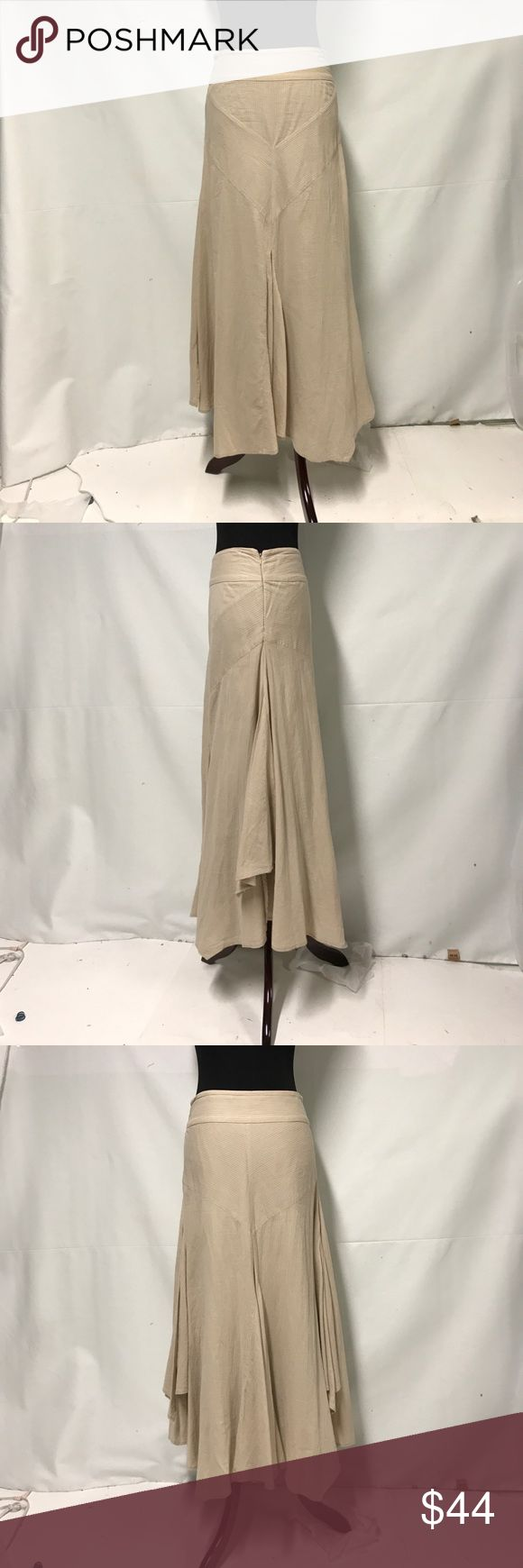 FREE PEOPLE tan maxi skirt w/ kickpleats The coolest skirt ever.. Fitted top with front and back kickpleats. Each side also has kickpleats but the hem length of the pleats I'd shorter than the front and back hem. It is a kind of boho fit and flare style. Side zip. There is a lining under about half the skirt. Free People Skirts Maxi