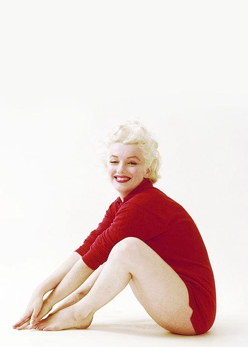 Marilyn Monroe. Red sweater sitting. Photo by Milton Greene, 1955.