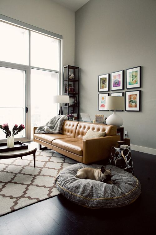 Love the carpet and the wall color! I think it needs a sun-bleached amethyst and turquoise ikat pillow on that couch to pick up the colors in the paintings and add a pop of color!: Interior Design, Idea, Living Rooms, Leather Couch, Leather Sofa, Wall Color, Livingroom, Grey Wall