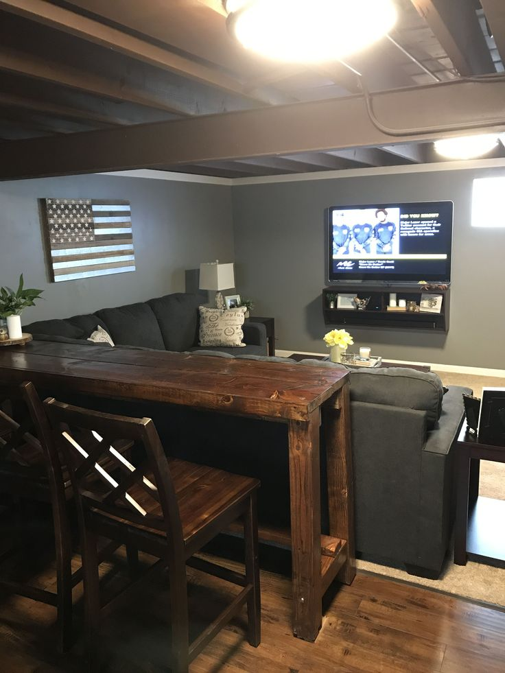 Basement remodel. Man cave. Painted ceiling. Home made bar and bar table. Barn door. Wall mount TV #Basement bar