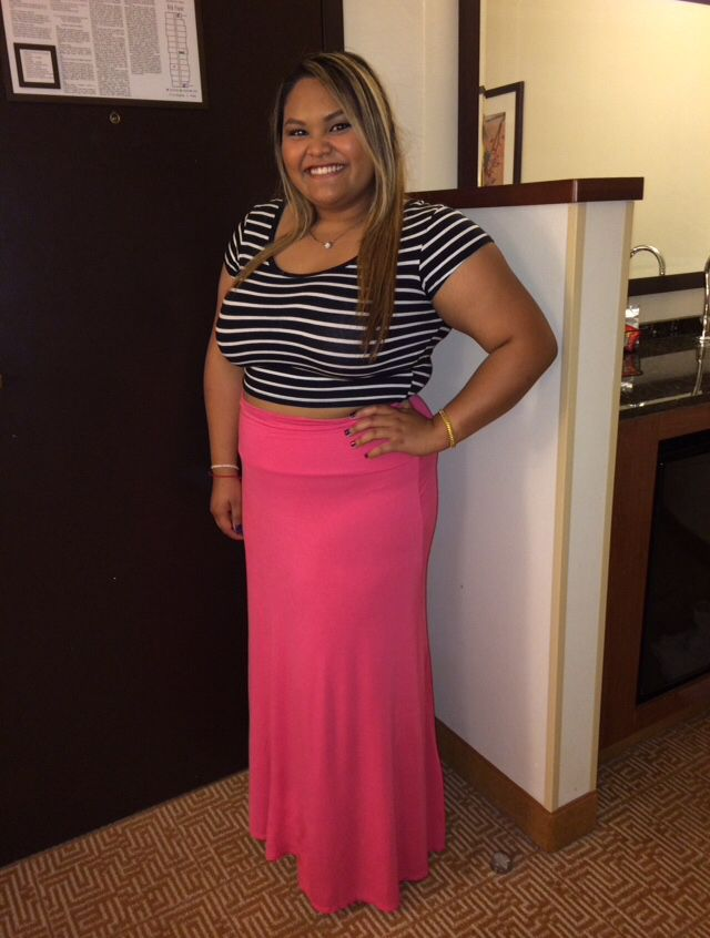 Black and white striped crop top, pink maxi skirt, and black sandals. Perfect for a summer day.