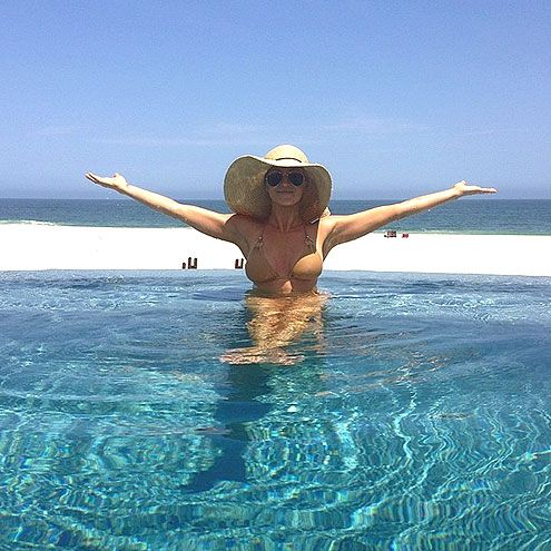 Kellie Pickler in a pool overlooking Cabo San Lucas, Mexico