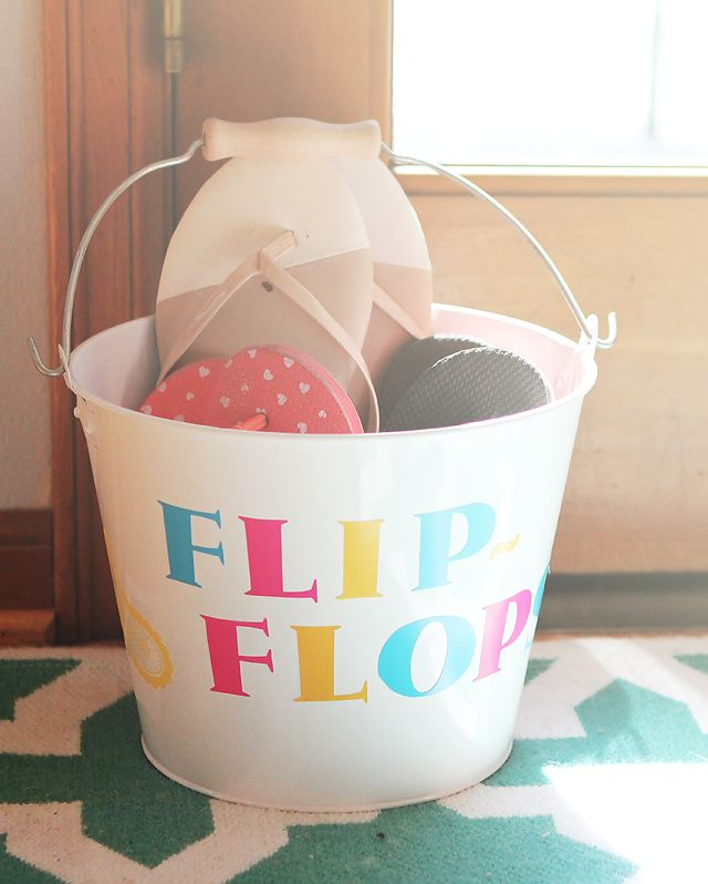 DIY Family Flip Flops Bucket - Need to make this and keep by the back door so my 3 year old will stop getting slivers from the deck!