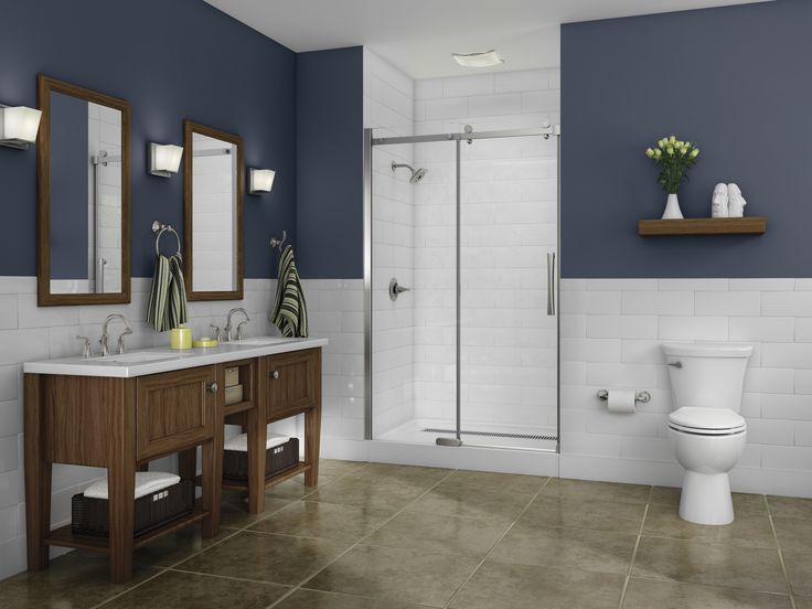 Steel blue bathroom with wood accents and white trimmings give it a cottage feel. The floating shelf above the toilet is a nice touch (not to mention easy and cheap to DIY!). Brushed nickel faucets and shower head from  the Delta Faucet Mandara collection.