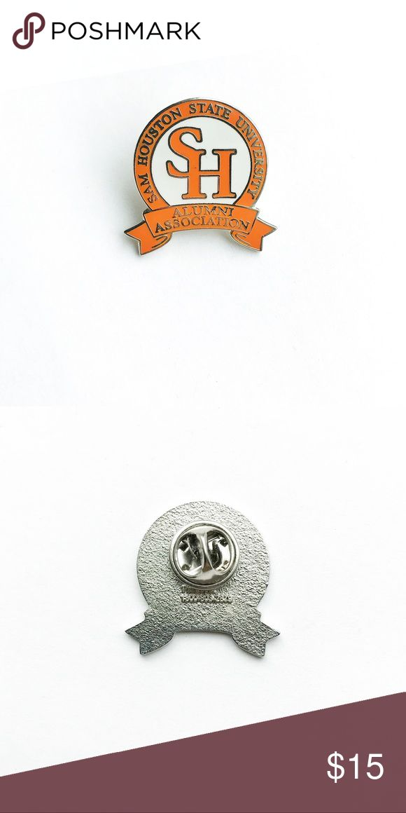 """Vintage San Houston University Pin Vintage Sam Houston University Alumni Association Enamel Pin  • true vintage • 1"""" x 1"""" • colors: silver, orange, white • tags: hat, lapel, jacket, tie, bag, backpack, college, graduate, graduation, SH, banner, major, minor, student, professor, alumnus, accessory, seal, school • all of the pins I sell are vintage & may contain minor nicks, imperfections, or oxidation Vintage Accessories"""