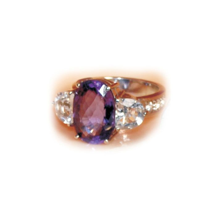 A statement ring in sterling silver set with a central purple amethyst flanked by 2 triangular cut citrines. These gemstones are hand cut and hand set bringing out the vibrancy of the gemstone.