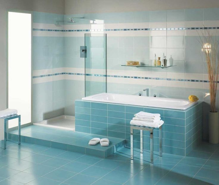 Bathroom Blue Wall Tile Designs Ideas with modern blue color tile wall and floor as well shower corner beside window and glass shelves above bathtub