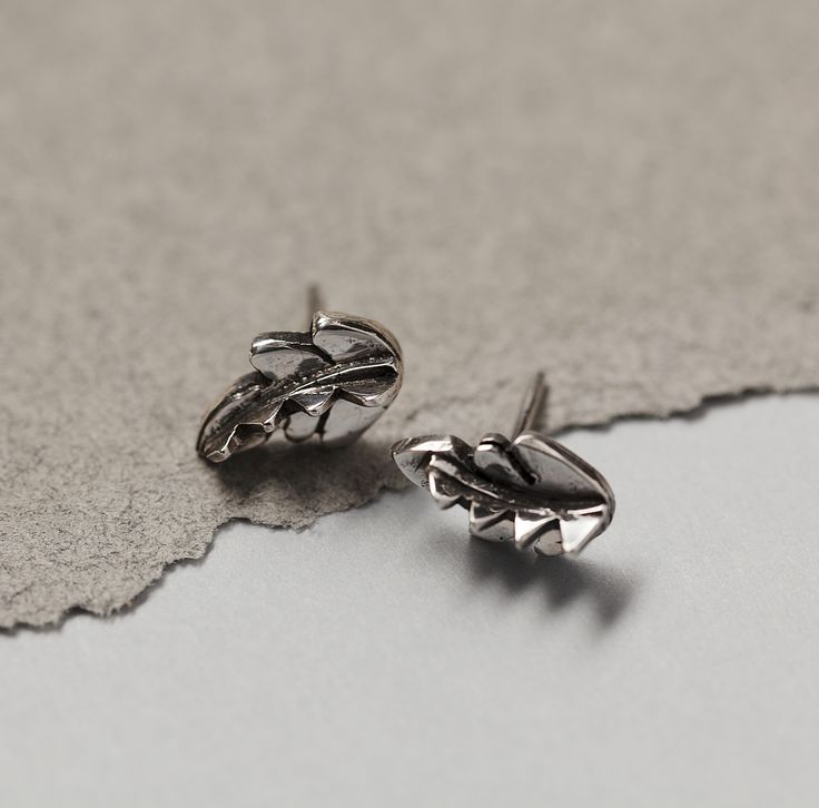 Tiny stud earrings by SOTINE.  Material: 92.5% silver  Designed in: The Netherlands  Crafted in: The Netherlands