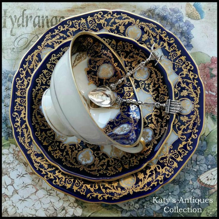 Hutschenreuther Hohenberg - Ornately gilded cobalt tea cup trio, Germany, 1933 and Italian silver tea spoons.
