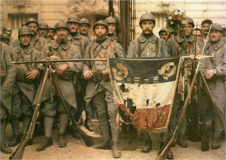 "greatwar-1914: "" A battle-hardened French platoon proudly displays their torn flag. """