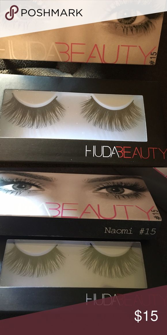 HUDA BEAUTY Naomi #15 faux mink lashes Naomi #15 HUDA Beauty  Mink false eyelashes Medium volume style Hair Length: 0.7 to 2.1cm (all lashes are handcrafted so may vary) Band length: 3.5cm Band thickness: 1mm Can be worn up to 15 times depending on care Glue sold separately Made with cruelty-free faux mink fur.  Brand new in box Huda Beauty Makeup False Eyelashes