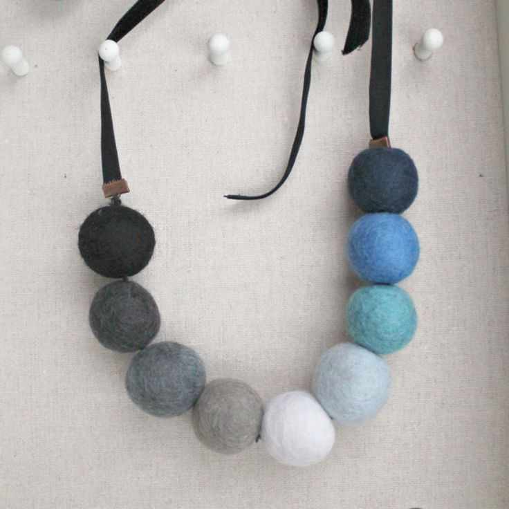 The Gum Ball felt and velvet beaded necklace. Bold colors and a big size makes a statement while keeping things fun and not too serious. Velvet ties add a bit of wintry luxe and are soft against the s