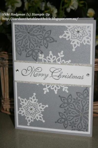 christmas stampa stack 2013 003 -  Vicki Hodgman, Festive Flurry stamp set and framelits. White Emboss Powder, Silver Emboss Powder, Smoky Slate Ink. Smoky Slate, whisper white, brushed silver, silver glimmer card.