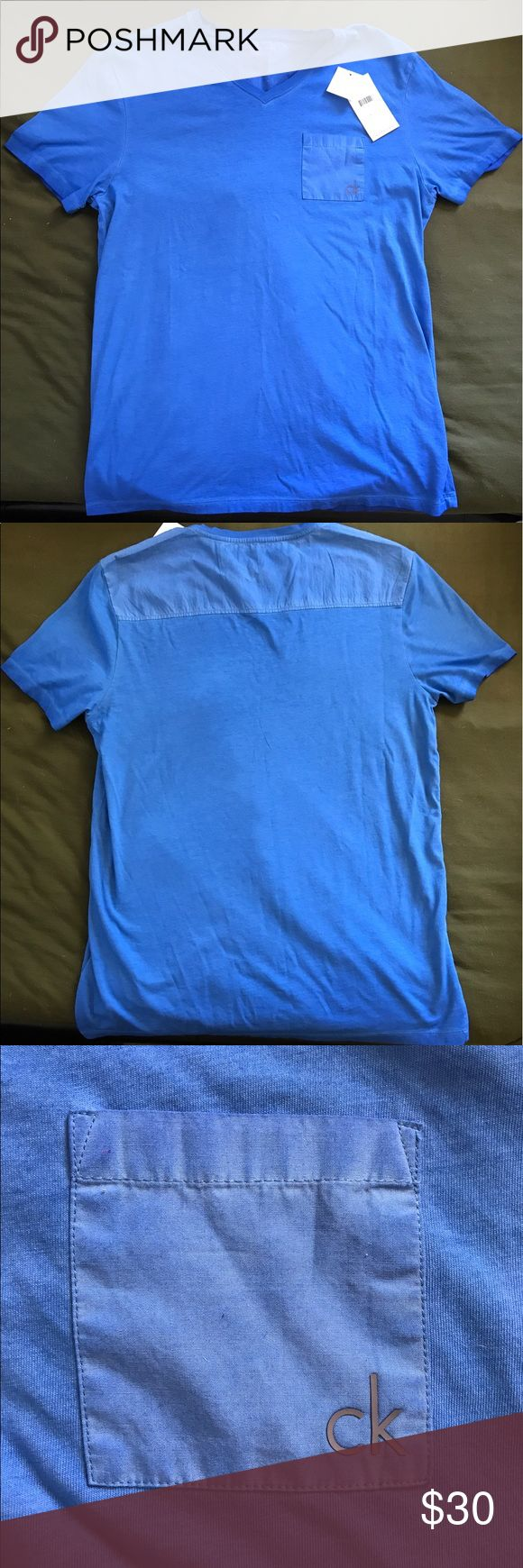 "Brand NWT Calvin Klein T Shirt This shirt is brand new with the tags still attached! A beautiful blue color, with a pocket on the left side of the chest hat has ""ck"" on it in grey. This shirt has never been worn and the price paid was $40. It is a size Medium, men's t shirt. ☺️ Calvin Klein Shirts Tees - Short Sleeve"