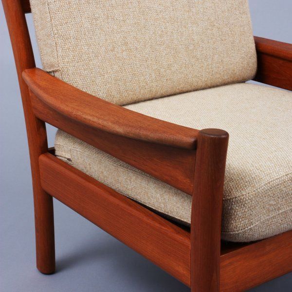 Circa 1960  Sturdy and classy easy-chair that features a solid teak frame and original light beige mottled wool fabric.