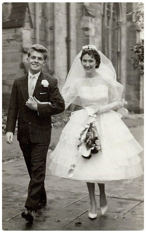1950's Wedding, My Aunt's dress was very similar, I think she wore 5 net underskirts to make it stick out like this :)