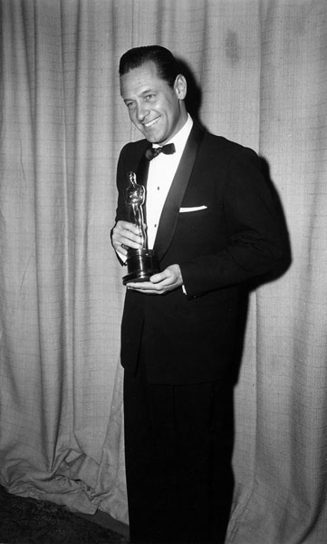 Academy Awards 1954. William Holden wins his Oscar for 1953's Stalag 17.