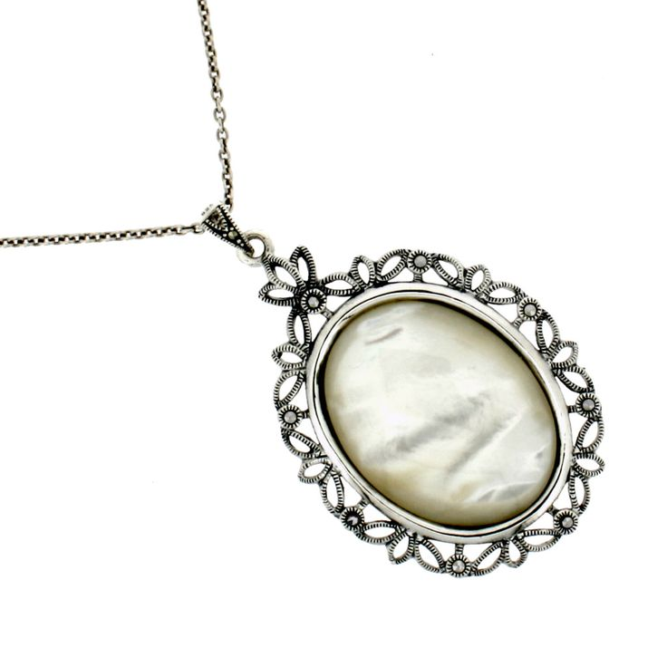 """Mother of Pearl Marcasite Necklace €165.00 A large oval Mother of Pearl is the centrepiece of this large pendant surrounded by marcasite and all set in sterling silver.  The cream white colour of the Mother of Pearl really works well with the subtle greys of marcasite.  The back of this pendant also has an ornate silver design and can be worn both ways.  This pendant brings a modern twist to a vintage Art Deco design.  It comes with an 18"""" sterling silver chain, other lengths available on…"""