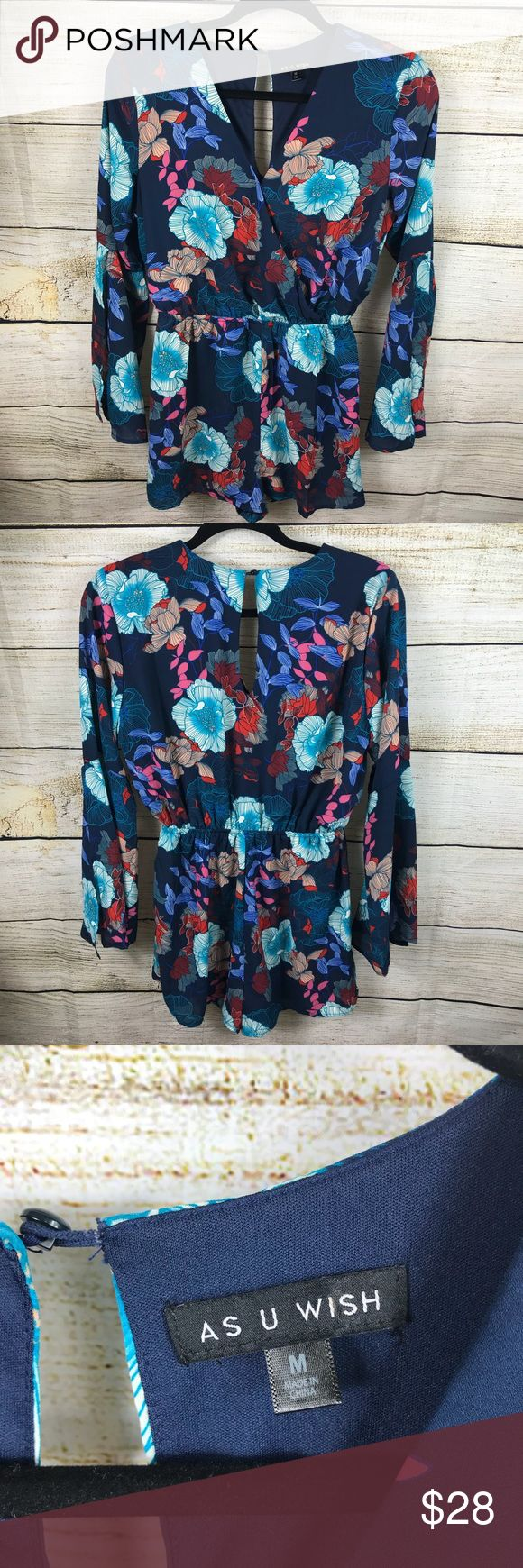 As U Wish Romper Excellent preowned condition. Size medium. Blue with floral print. Long sleeves that open up. Button closure near neckline. From Dillard's. Has a lining. As U Wish Pants Jumpsuits & Rompers
