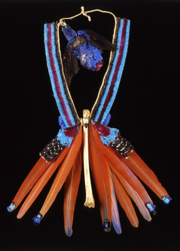 Brazil | Ceremonial necklace from the Urubu people | Money bone whistle, feathers, vegetal fiber: