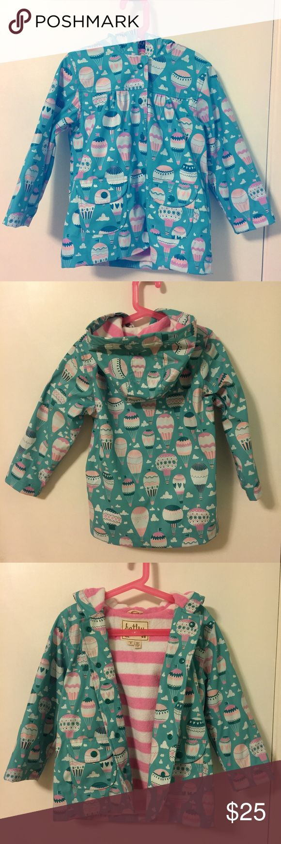 Hatley girls raincoat Cute rain jacket featuring hot air balloons was originally purchased at Bloomingdales. Excellent used condition, beautiful color and pattern. Warm fuzzy lining is perfect for fall. Hatley Jackets & Coats Raincoats