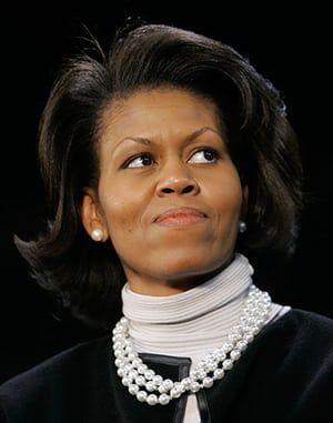 Michelle Obama at 50: February 2007: Michelle Obama, wife of US Senator Barack Obama, listens to