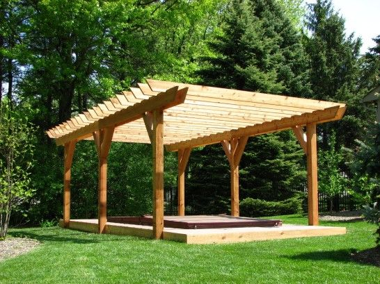 simple design of Wooden Gazebo Kits in the backyard surrounding fresh plants and charming ceiling detail