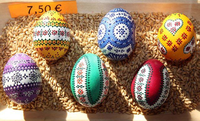 Painted Easter eggs sit on display for sale at the annual Sorbian Easter market on March 16, 2013 in Schleife, Germany. Easter is a particularly important time of year for Sorbs, a Slavic minority in eastern Germany, and the period includes the tradition of painting Easter eggs that include visual elements intended to ward off evil. Many Sorbs still speak Sorbian, a language closely related to Polish and Czech.  (Photo by Adam Berry)