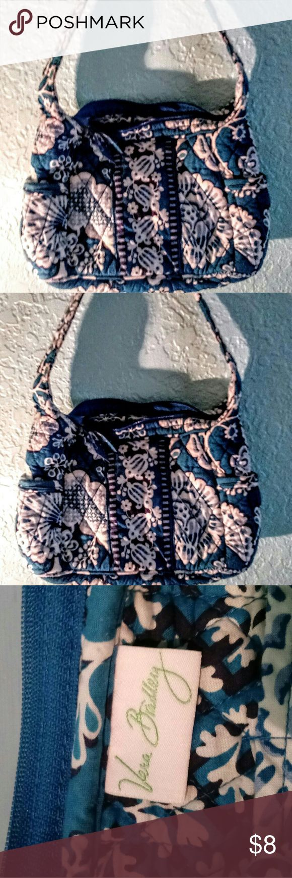 Vera Bradley Blue and White Purse Like New Vera Bradley small Blue and White Purse. With side pockets and a zipper to close on top.  7 inches long 10 inches wide Strap is 9 inches long. Vera Bradley Bags Mini Bags