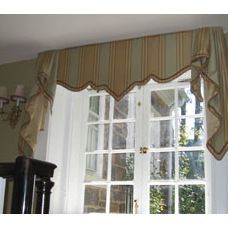Add interest to a boxy room with a shaped valance.