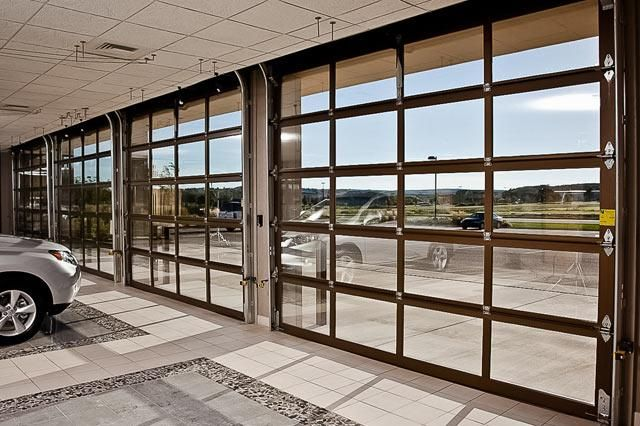 Commercial gallery doors with glass inset into an aluminum frame - the epitome of class.