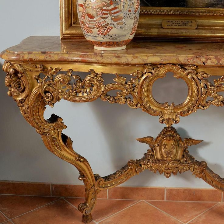 Spectacular #console in #giltwood with gold leaf, carved and preforated decor of shells, scrolls and floral garlands in fall. Top in precious #breccia #marble from Aleppo. First half of the #19th century, Louis XV style. For sale on #Proantic by La Corte Degli Ulivi Gallery.
