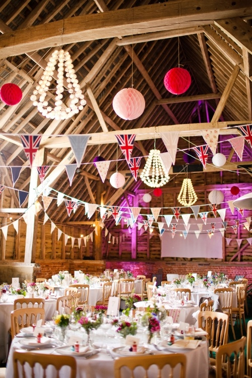 This is a lot busy, but love the idea of flag banners in our beautiful barn; maybe we can hang them from bar / tables / over doors even if we can't suspend them?