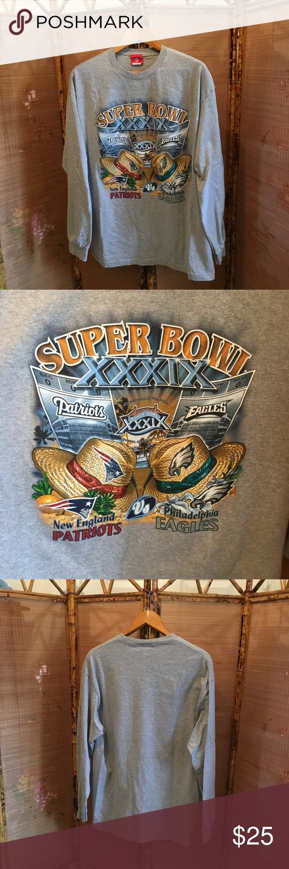 2005 Super Bowl XXXIX long sleeve tee shirt NWOT NFL 90% cotton 10% polyester pre-shrunk gray long sleeve tee shirt from 2005 Super Bowl XXXIX. This game between New England Patriots and Philadelphia Eagles was the only one held in Jacksonville Florida to date. Shirt front has the game information, logo, and tan straw hats instead of helmets, all in both teams' colors. Ribbed neckline and cuffs. Back is solid gray. All items come from a smoke free home. Measurements available upon request…