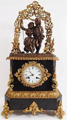 Antique clocks -Early 1800's French bronze ormolu & black marble mantle clock