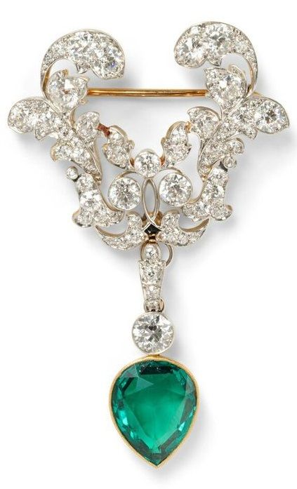 Edwardian Emerald and Diamond Brooch, the drop set with a pear-shape emerald…