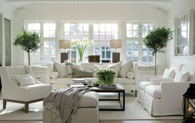 White furniture + dark coffee table and dramatic greenery.   **The sofa and chairs are different, unrelated styles but look great together.