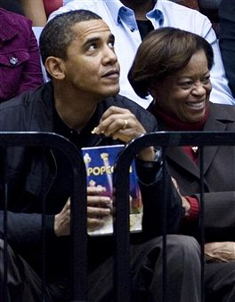 #44thPresident #BarackObama and his mother in law Marian Robinson watch a basketball game at George Washington University November 28, 2009 in Washington, DC. President Barack Obama attended the game between George Washington University and Oregon State, which is coached by his brother-in-law Craig Robinson.Less