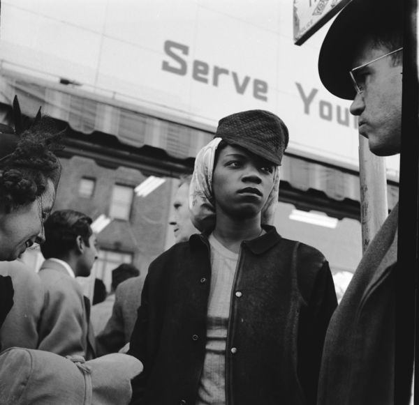 Female, African American shipyard worker standing in front of a store in Richmond, CA.  1943.  Dorothea Lange, photographer