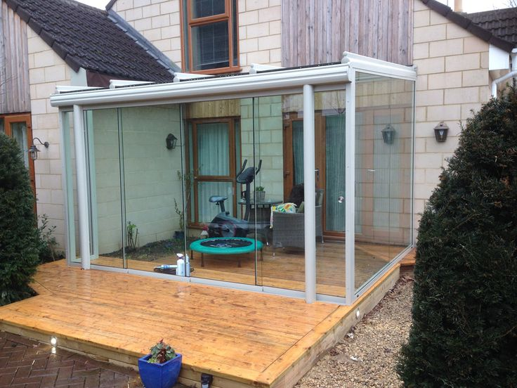 A simplistic, cosy glass house mounted on decking - Build completed by OpenSpace Living
