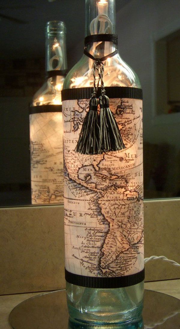 Recycled wine bottle lamp covered with vintage world map and tassle trim