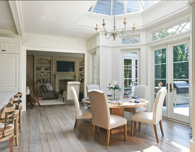 This eating area is super inviting!  I am loving the ceiling, the doors and windows.