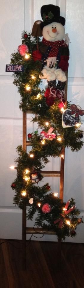 Christmas Ladder - My way of using the antique ladder my husband built for me that can no longer be used the way it was intended - this way I don't have to throw it out.: