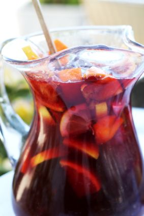 Sangria for girls night! Two bottles of red wine Four shots of Triple Sec Two lemons, cut into slices Two limes, cut into slices Two oranges, cut into slices One large bag of frozen mixed berries (strawberries, raspberries, blackberries and blueberries) One bottle of lemon-lime pop Ice