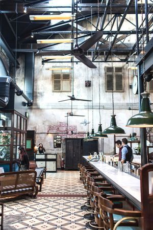 Dishoom at Kings Cross - cool conversion the Victorian  warehouse and stables into a stunning three-story restaurant.