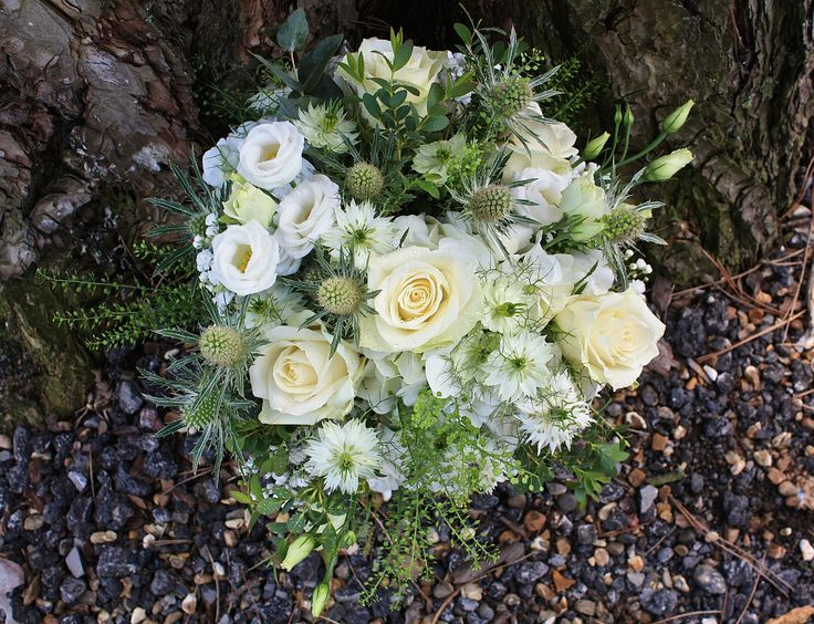 Simple white posy with thistles, nigella, roses & lizyanthus